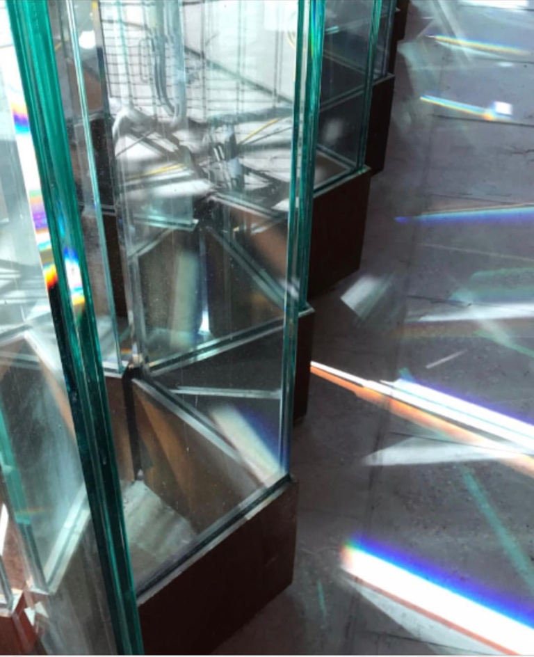Hackney Wick Station - Detail View Of Molecular Glass Wall Installation with sunlight refracting through the glass by Collaborating Artist Wendy Hardie 2018