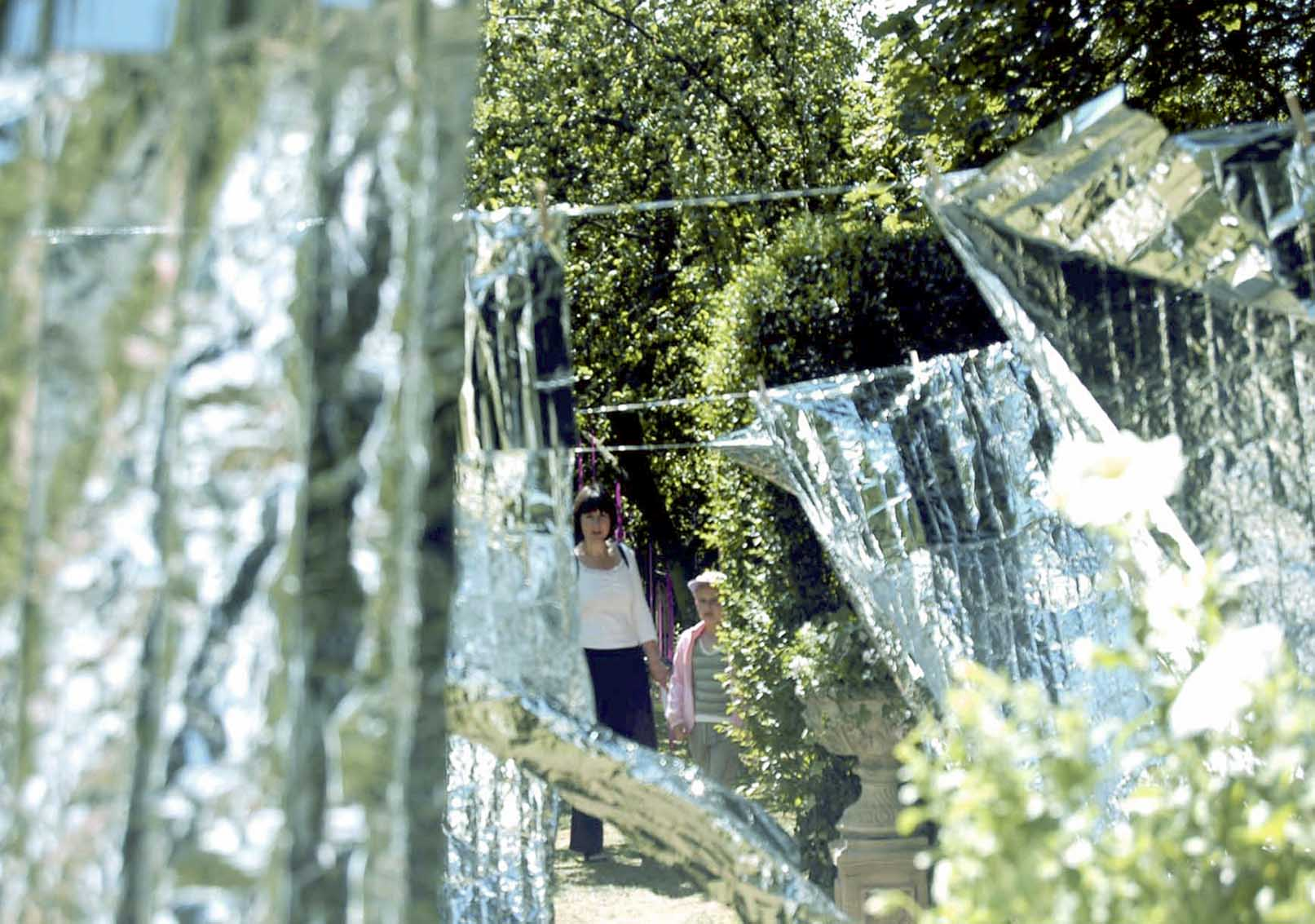 'Laundry Day' by artist Wendy Hardie. A site specific environmental art installation of rows of emergency blankets on silver washing lines, Durham 2006.